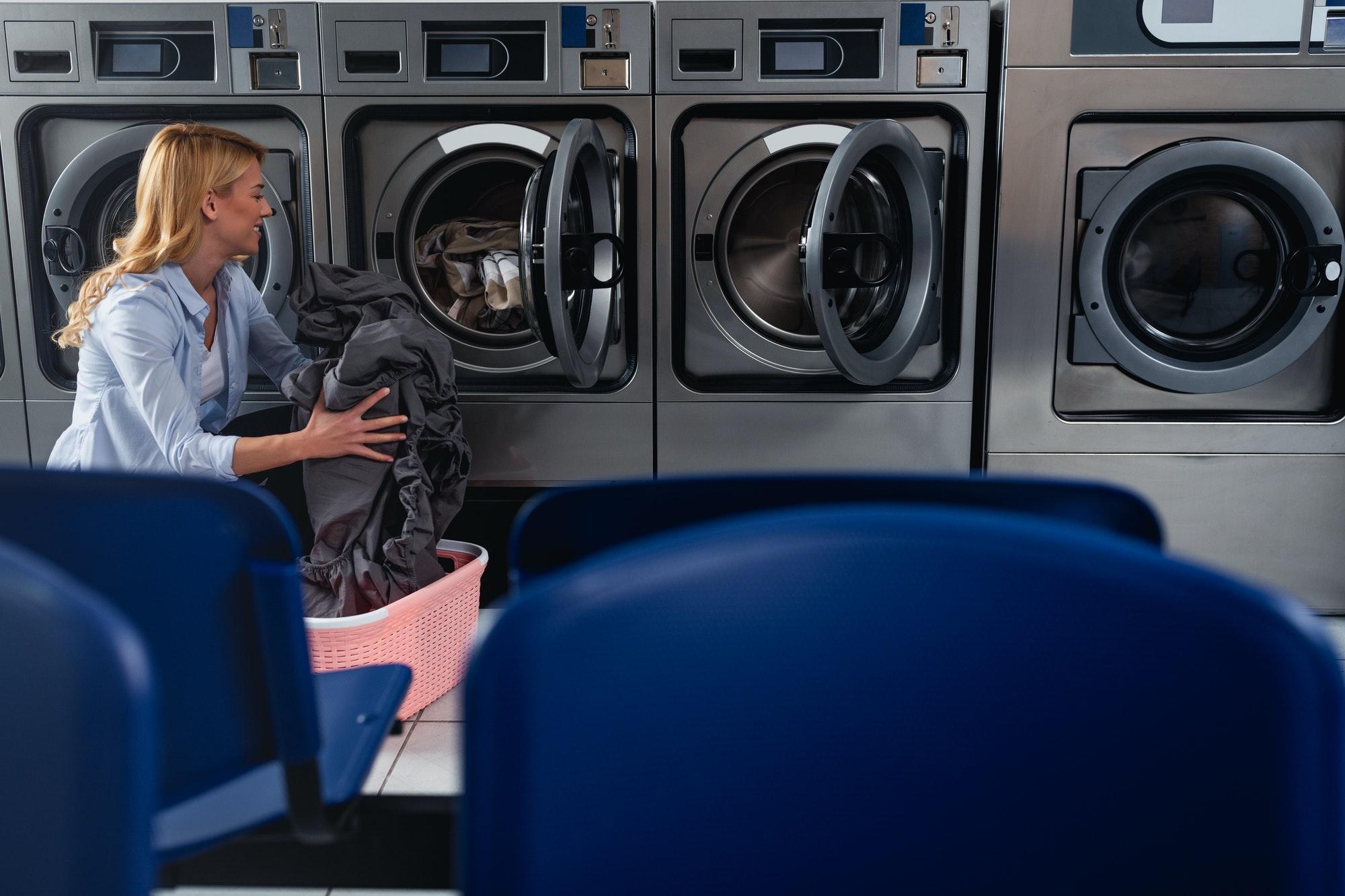 Female doing laundry at laundromat