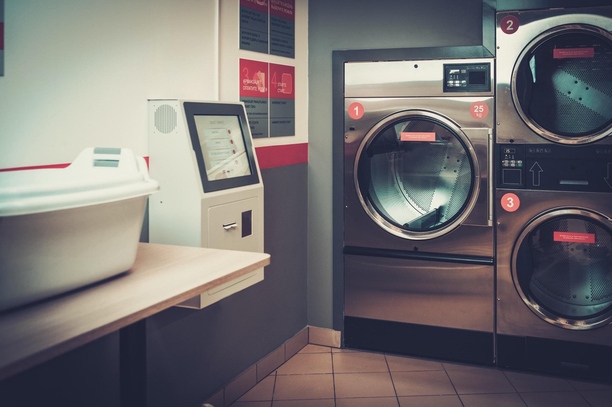 Laundry machines at laundromat shop.